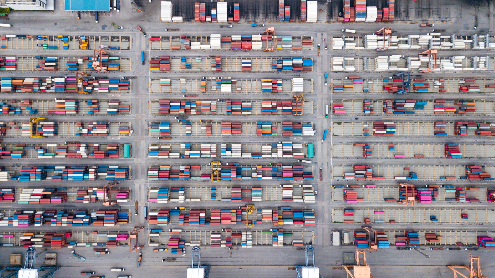 aerial top view of logistics import and export transportation of Container Cargo ship in shipyard at the port